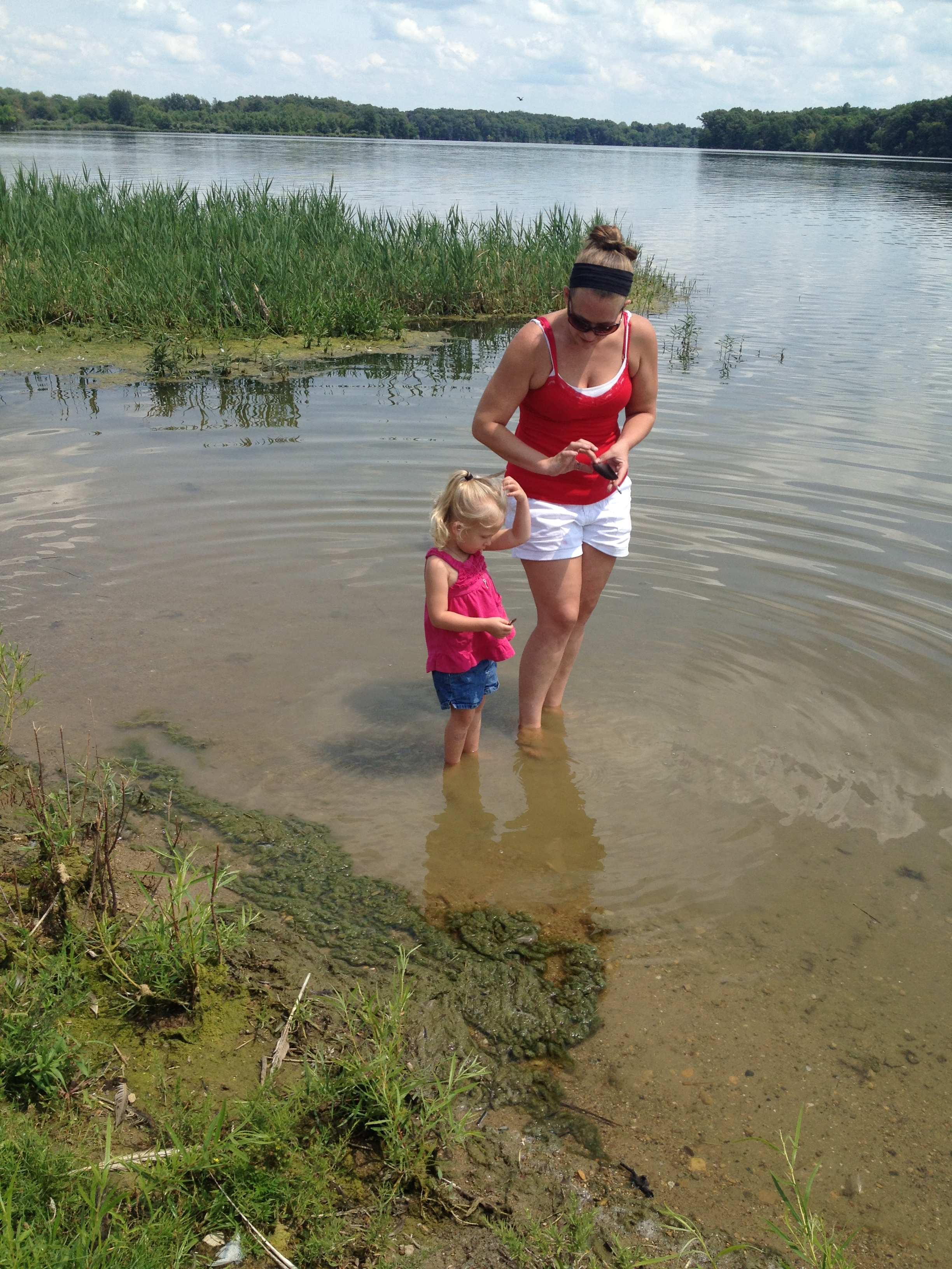 Momma and small child playing at the edge of a beautiful lake! Baptised in Muddy Water!